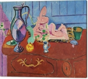 pink-statuette-and-a-pitcher-on-a-red-chest-of-drawers-1910-henri-matisse-canvas-print